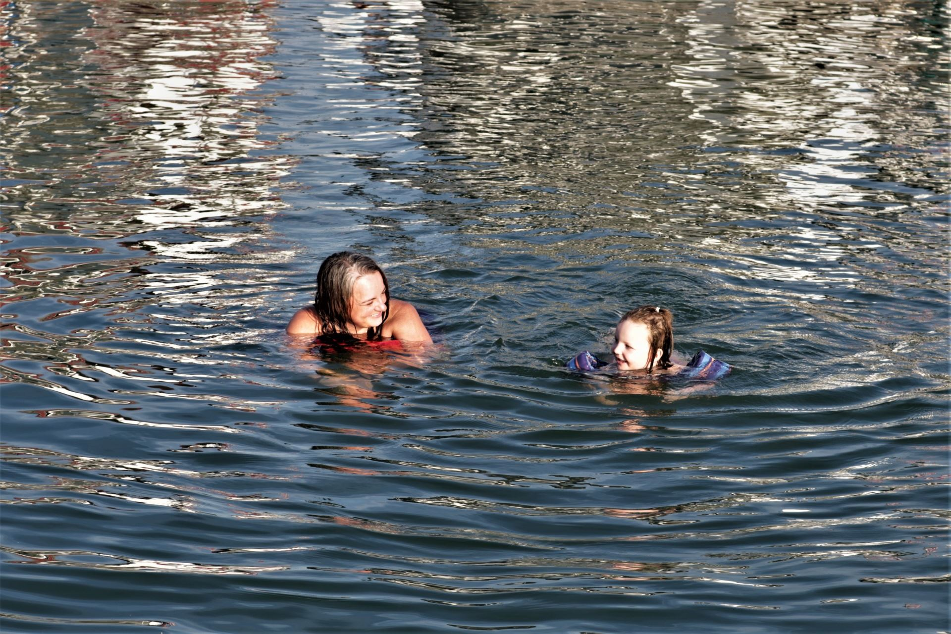 mother-and-child-swimming-in-lake