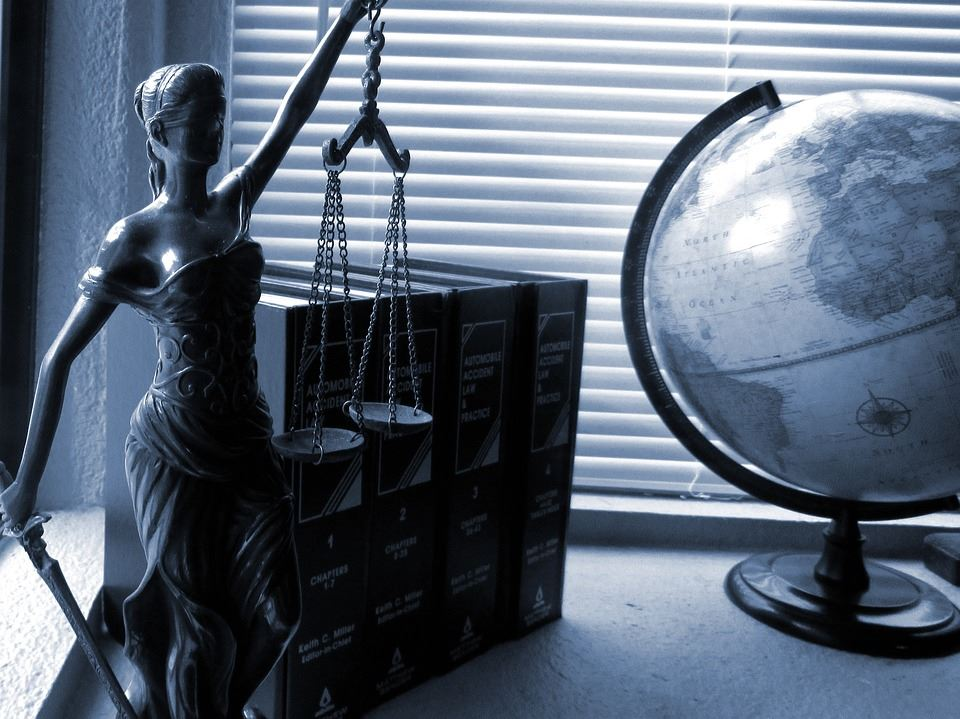 Lady Justice with books and globe